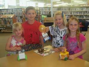 Charles, Layne, Abbey and Maddison with their balloon cars