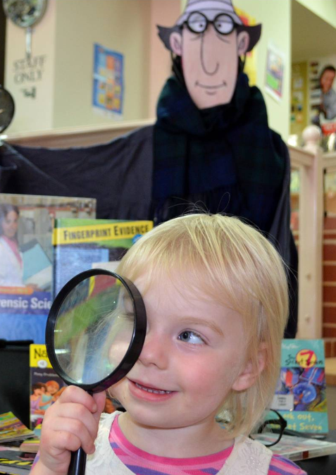 Carys Van Der Woude enjoys Investigating in the library!